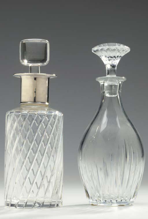 THREE GLASS DECANTERS,