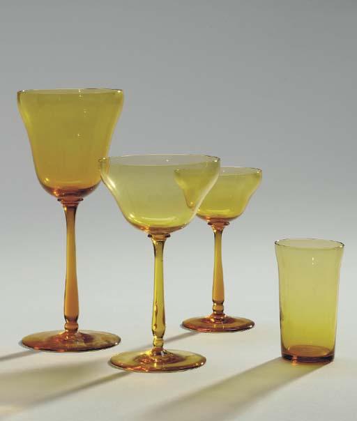 AN AMBER GLASS PART STEMWARE SERVICE,