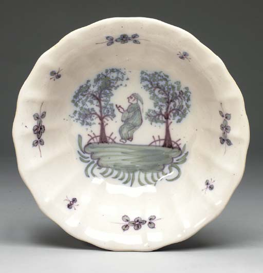 A CONTINENTAL FAIENCE LOBED BOWL,