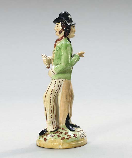 A STAFFORDSHIRE FIGURE OF JANU