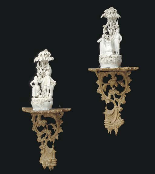 A PAIR OF EARTHENWARE FIGURAL