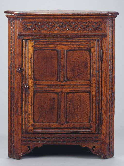 A JACOBEAN STYLE CARVED OAK CO