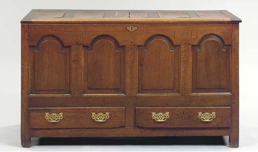 A PROVINCIAL GEORGE II CARVED OAK BLANKET CHEST