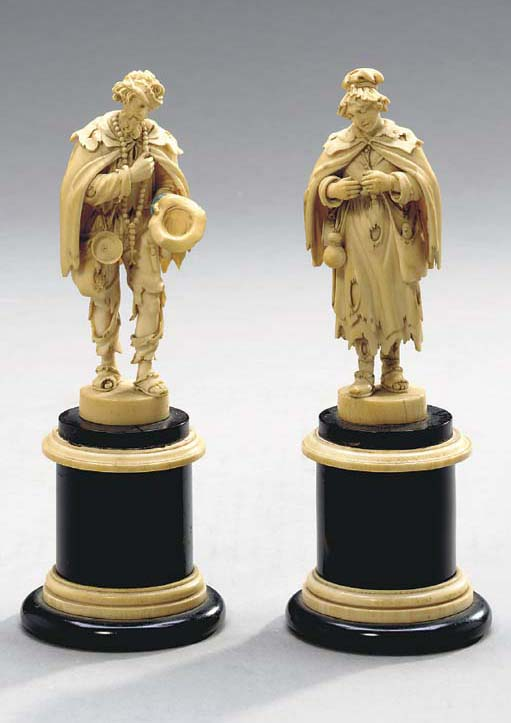 TWO FRENCH CARVED IVORY FIGURES,**