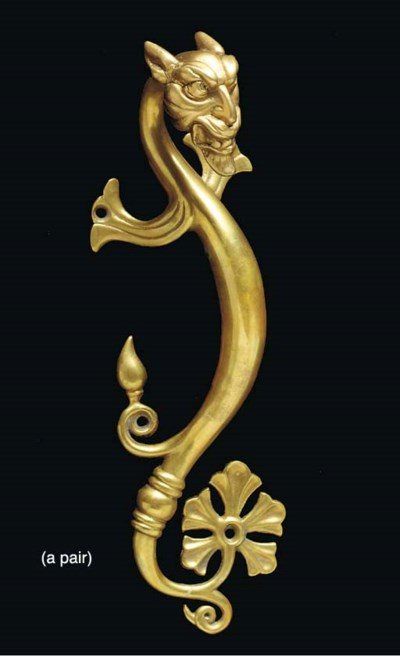 A PAIR OF CAST BRASS FIGURAL H