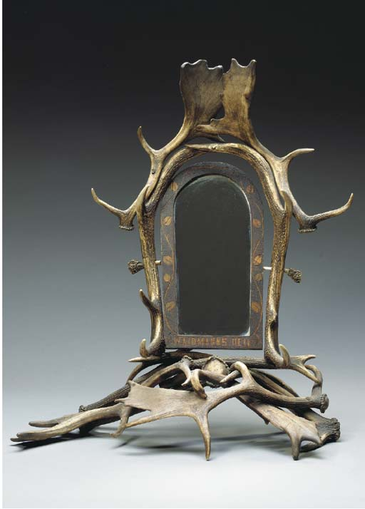 AN ANTLER DRESSING MIRROR,