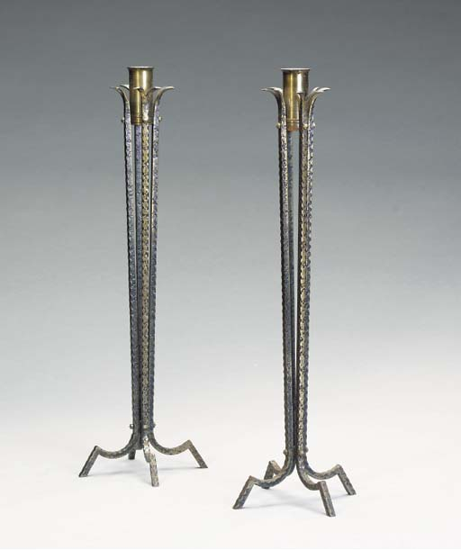 A PAIR OF ART DECO STYLE HAMMERED METAL CANDLESTICKS,