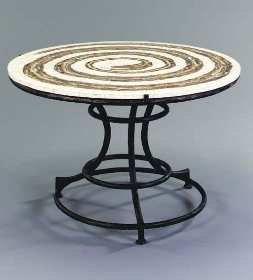 AN AGATE AND CREME STONE VENEERED CENTER TABLE ON A PATINATED BRONZE BASE,
