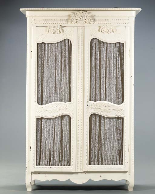 A FRENCH PROVINCIAL CREME CARVED AND PAINTED ARMOIRE,