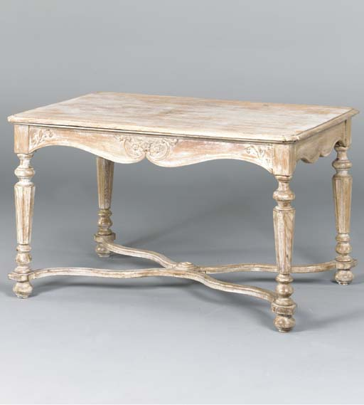 A FRENCH PROVINCIAL LINED OAK CENTER TABLE
