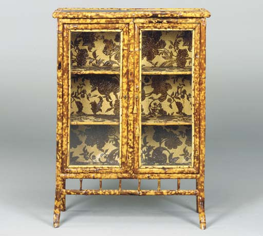 A BAMBOO LACQUERED AND EMBOSSED PAPER DECORATED SIDE CABINET,