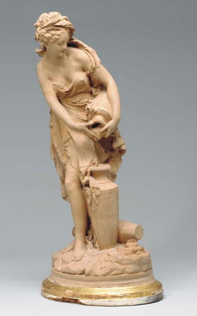 A FRENCH TERRACOTTA FIGURE OF