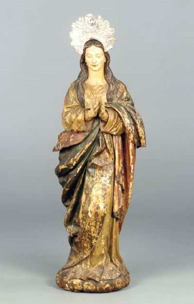 A POLYCHROME DECORATED AND SIL