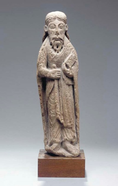 A SPANISH LIMESTONE FIGURE OF