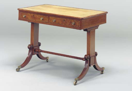 A REGENCY MAHOGANY PALE GREEN LEATHER INSET WRITING TABLE,