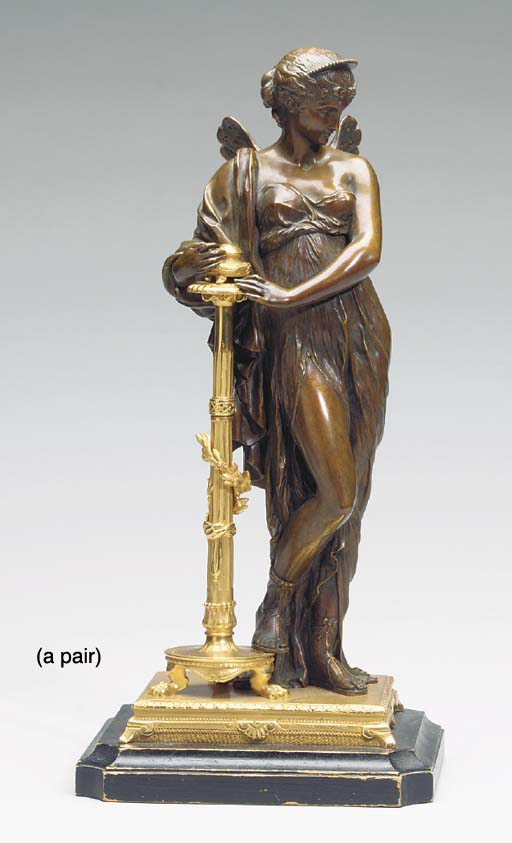 A PAIR OF NEOCLASSICAL PATINATED AND GILT BRONZE FIGURES OF NYMPHS ON LATER WOODEN BASES