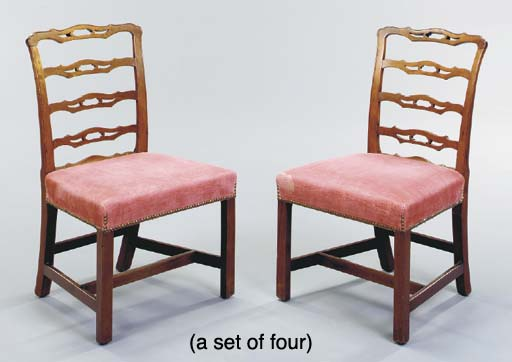A SET OF FOUR GEORGE III MAHOGANY LADDER BACK DINING CHAIRS