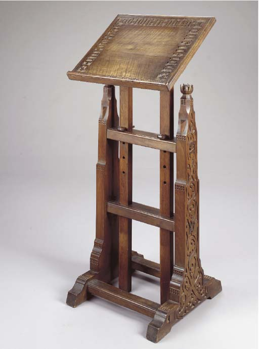 A CARVED WALNUT LECTERN