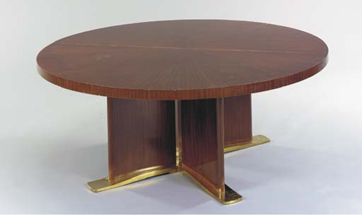 AN ART DECO STYLE MAHOGANY DINING TABLE,