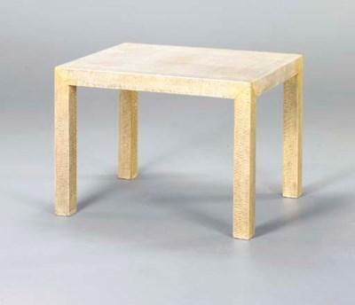 A MODERN SNAKESKIN LOW TABLE,