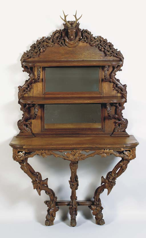 A BLACK FORREST CARVED CONSOLE