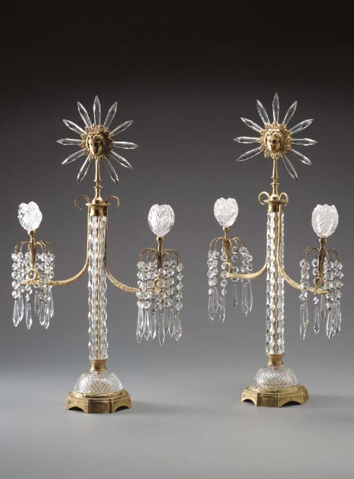 A PAIR OF REGENCY STYLE ORMOLU AND CUT-GLASS TWO-LIGHT CANDELABRA,