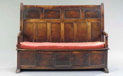 AN ENGLISH OAK SETTLE,