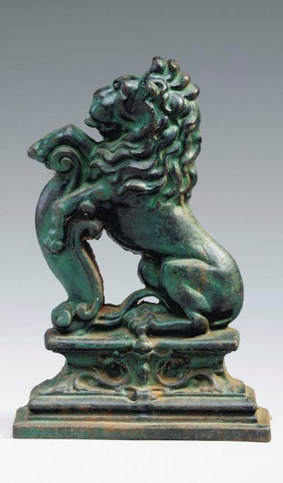 AN ENGLISH GREEN PATINATED IRO