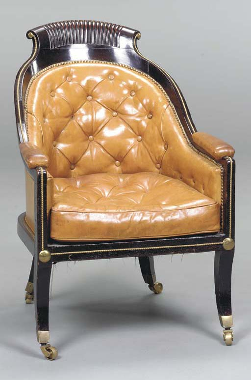 A REGENCY GILT-BRONZE MOUNTED AND EBONIZED LIBRARY CHAIR,
