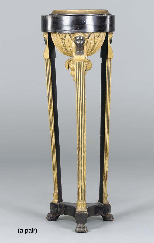 A PAIR OF CONTINENTAL NEOCLASSIC BLACK PAINTED AND PARCEL-GILT TORCHERES,