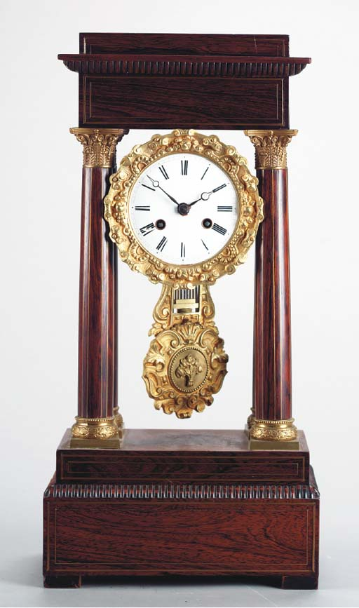 CHARLES X BRASS INLAID ROSEWOOD AND GILT BRONZE MOUNTED TEMPLE FORM CLOCK,