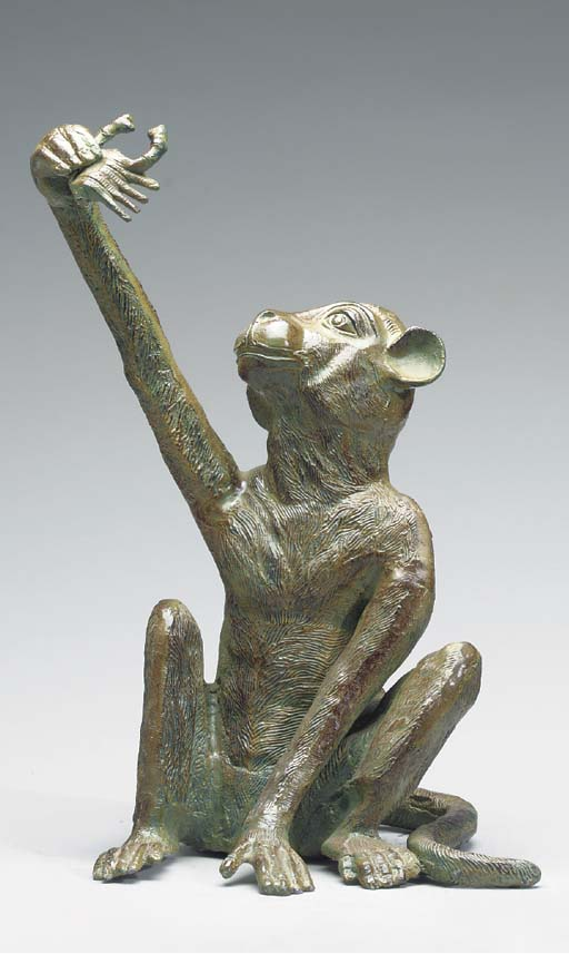 A PATINATED METAL FIGURE OF A