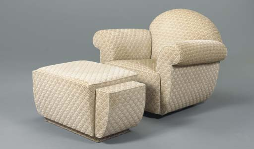 AN ART DECO STYLE UPHOLSTERED ARMCHAIR AND OTTOMAN
