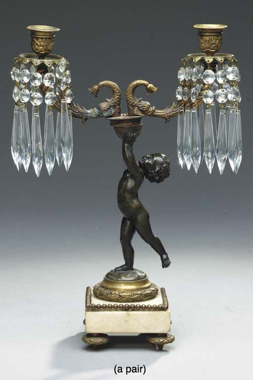 PAIR OF REGENCY STYLE PATINATED BRONZE CUT GLASS MOUNTED FIGURAL TWO LIGHT CANDELABRA,