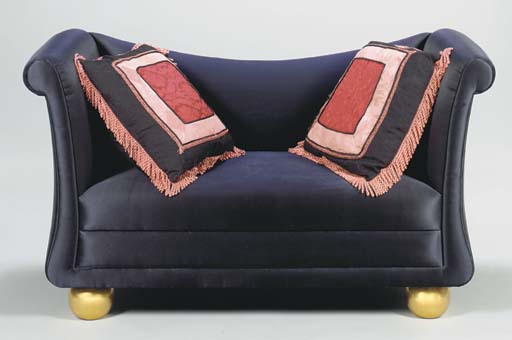 A NEOCLASSIC STYLE UPHOLSTERED