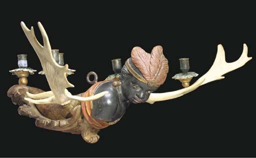 A BAVARIAN BLACKAMOOR AND ANTLER FIVE-LIGHT CHANDELIER,