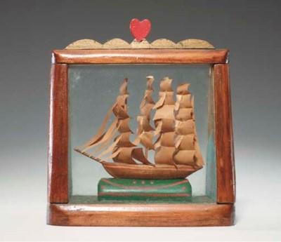 A miniature four masted ship i