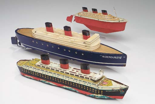 A wooden toy model, and two ti