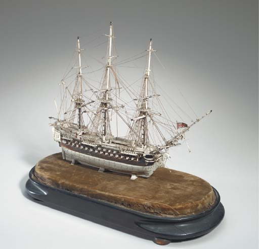 A fine small Napoleonic Prisoner of War model of a British 3rd Rate ship of the line in bone and tortoise shell