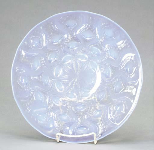AN IRIDESCENT GLASS DISH,