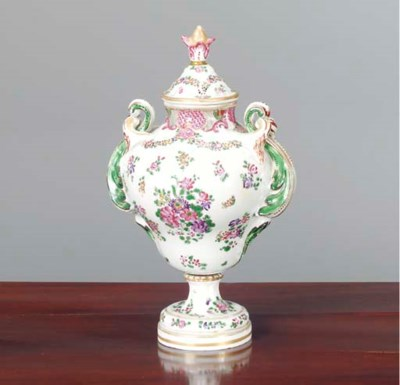 A PORCELAIN URN AND COVER IN T