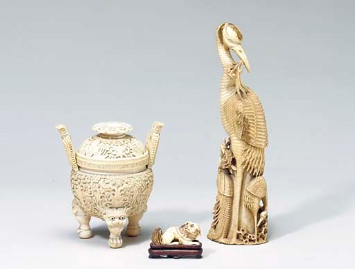 A GROUP OF CARVED IVORY OBJECT