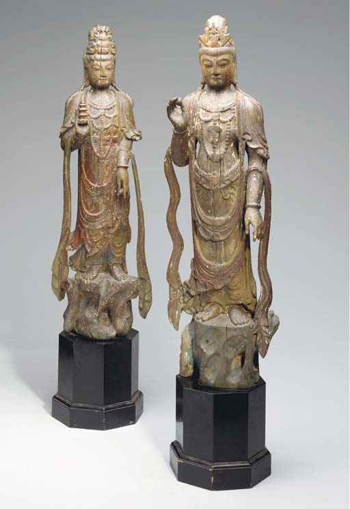 A PAIR OF CARVED WOOD AND POLY