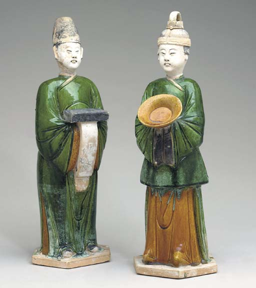 A PAIR OF GREEN-GLAZED POTTERY