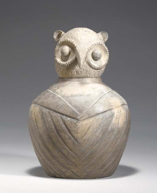 A GREY POTTERY OWL-FORM JAR AN