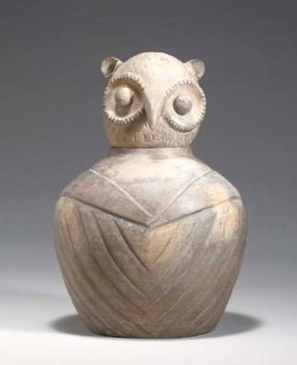 A GREY POTTERY OWL-FORM JAR AN