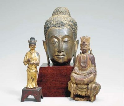A THAI GILT-BRONZE HEAD OF BUD