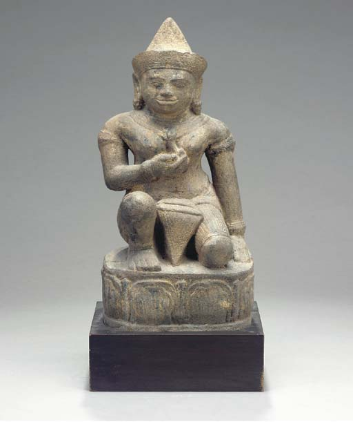 A CARVED STONE FIGURE OF A DEI
