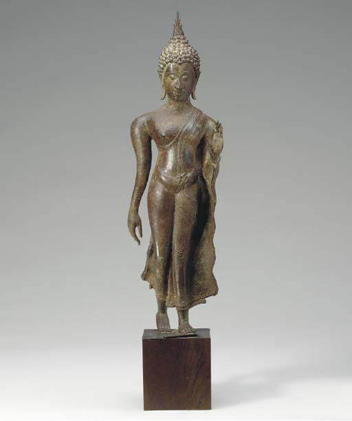 A PATINATED BRONZE THAI FIGURE