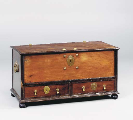 A COLONIAL HARDWOOD COFFER,